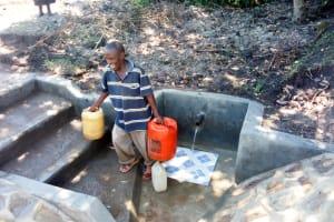 The Water Project: Muyundi Community, Baraza Spring -  Flowing Water