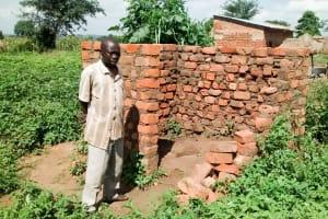 The Water Project: Alimugonza Pabidi Community -  Peter Okello In The Midst Of Building A New Latrine