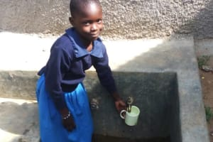 The Water Project: Bumini Primary School -  Getting A Drink Of Water