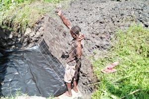 The Water Project: Ewamakhumbi Community, Yanga Spring -  Laying The Foundation