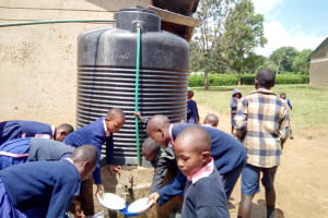 The Water Project: Friends Kaimosi Demonstration Primary School -  Students Getting Water From One Of The Plastic Tanks