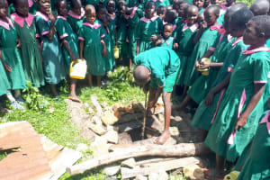 The Water Project: Mavusi Primary School -  Drawing Up Water In A Bucket
