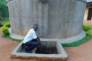The Water Project: Bumira Secondary School -  A Student Fetches Water