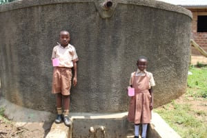 The Water Project: Compassion Primary School -  Students Pose With Water The Collected From The Tank