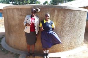 The Water Project: Kakubudu Primary School -  Field Officer Janet Kayi And Juliana Nekesa