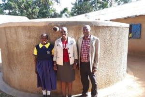 The Water Project: Kakubudu Primary School -  Juliana Nekesa Janet Kayi And Mr Solomon Busumu At The Tank