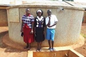 The Water Project: Mwiyenga Primary School -  Field Officer Betty Muhongo With Mary Lamuka And Protus Musonye