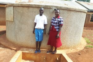 The Water Project: Mwiyenga Primary School -  Protus Musonye And Field Officer Betty Muhango