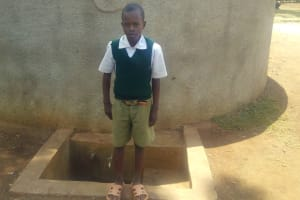 The Water Project: Esibuye Primary School -  Student Poses In Front Of Tank