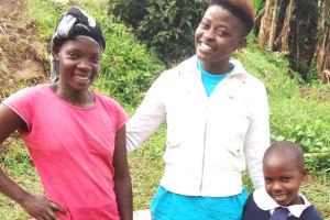 The Water Project: Shiamboko Community, Oluchinji Spring -  Betty Nambiro Field Officer Jemmimah Khasoha And Emily Amwai