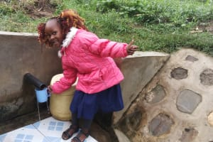 The Water Project: Shiamboko Community, Oluchinji Spring -  Thumbs Up For Reliable Water