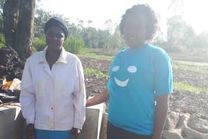 The Water Project: Mwiyala Community, Benard Spring -  Metrine Shilako And Field Officer Karen Maruti