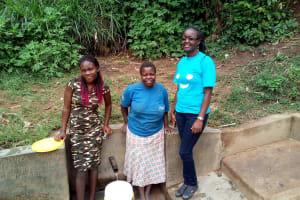 The Water Project: Handidi Community, Matunda Spring -  Magdalyne Wasambili And Field Officer Olivia Bomji At The Spring