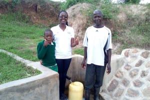 The Water Project: Mukhuyu Community, Shikhanga Spring -  Brighton Lirumba Field Officer Olivia Bomji And Charles Ashikanga