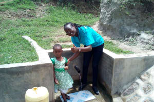 The Water Project: Mukhuyu Community, Shikhanga Spring -  Thumbs Up For Reliable Water