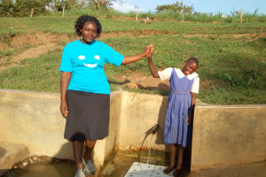 The Water Project: Ematiha Community, Ayubu Spring -  High Fives For Field Officer Karen Maruti And Mercy Amonyole