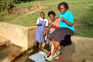 The Water Project: Ematiha Community, Ayubu Spring -  Mercy Amonyole Velma Anjeche And Field Officer Karen Maruti