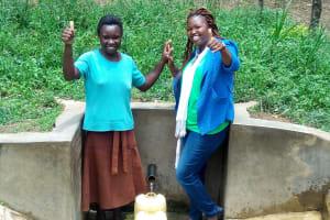 The Water Project: Mungulu Community, Zikhungu Spring -  Abigael Kasiti And Field Officer Jacklyne Chelagat
