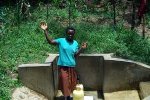 The Water Project: Mungulu Community, Zikhungu Spring -  Abigael Kasiti Fetching Water