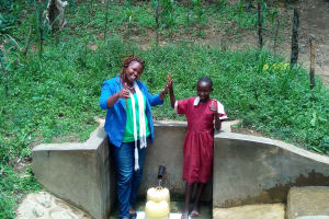 The Water Project: Mungulu Community, Zikhungu Spring -  High Fives For Reliable Water
