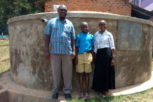 The Water Project: Eregi Mixed Primary School -  Alex Shikokoti Franklin Kiwanuka And Field Officer Joan Were