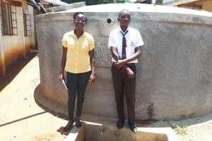 The Water Project: Mwitoti Secondary School -  Field Officer Olivia Bomji With Kennedy Munyani