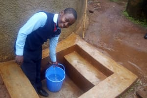 The Water Project: Ebubayi Secondary School -  Student Collects Water