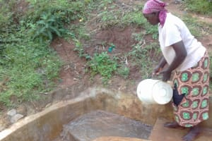 The Water Project: Lugango Community, Lugango Spring -  Margaret Cleaning The Spring