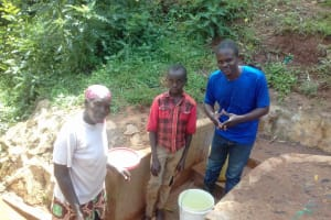 The Water Project: Lugango Community, Lugango Spring -  Margaret Lihanda Derick Maraha And Field Officer Samuel Simidi