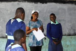 The Water Project: Mukunyuku RC Primary School -  Trainer Jacky And Jon Otembo