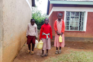 The Water Project: Irobo Primary School -  Students With Water Containers