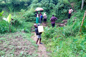 The Water Project: Bukhakunga Community, Khayati Spring -  Clyde Struggling To Lift Liters
