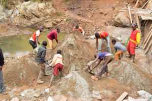 The Water Project: Kala Community -  Mixing Cement For The Dam