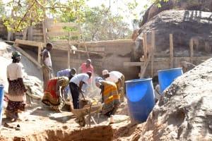 The Water Project: Ikuusya Community -  Sand Dam Construction