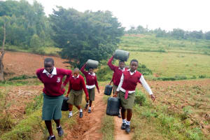 The Water Project: Kaimosi Demonstration Secondary School -  Carrying Water