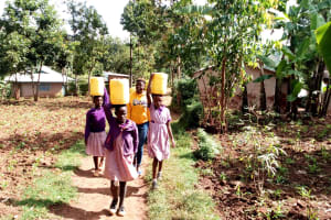 The Water Project: Magaka Primary School -  Carrying Water Back To School