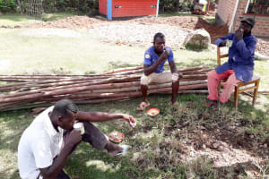 The Water Project: Kapsotik Primary School -  Artisans Breaking For Lunch