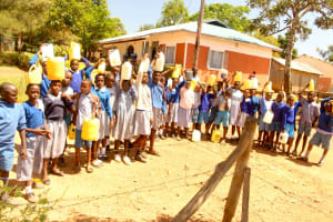 The Water Project: Lumakanda Township Primary School -  Students With Water Containers