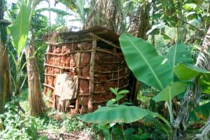 The Water Project: Sichinji Community, Makhatse Spring -  Mud Latrine