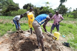The Water Project: Luyeshe Community, Matolo Spring -  Mixing Cement