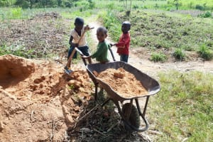 The Water Project: Luyeshe Community, Matolo Spring -  Kids Helping Their Fathers Work