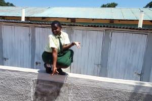 The Water Project: Precious School Kapsambo Secondary -  Sharon Mundia At The New Latrines