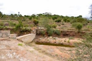 The Water Project: Kala Community -  Sand Dam Back