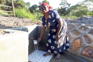 The Water Project: Luyeshe Community, Matolo Spring -  Bilha Matolo Gest A Fresh Drink
