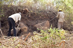 The Water Project: Masola Community A -  Harvesting More Stones For The Project