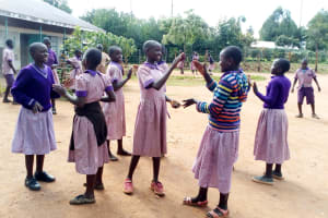 The Water Project: Magaka Primary School -  Girls Playing During Break