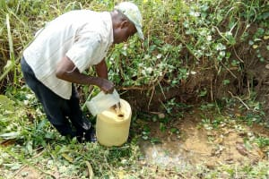 The Water Project: Lukova Community, Wasike Spring -  Fetching Water