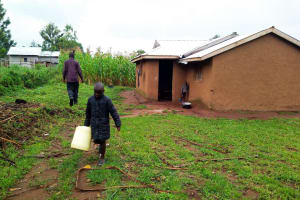 The Water Project: Bukhakunga Community, Khayati Spring -  Clyde Heading Off To Fetch Water