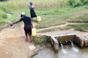 The Water Project: Irobo Primary School -  Support Staff Fetching Water