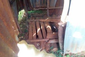 The Water Project: Mukangu Community, Lihungu Spring -  Dangerous Wooden Latrine Floor
